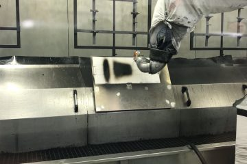 A paint robot sprays the pattern for scanning & quality and efficiency evaluation